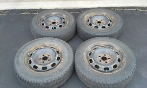 "Four 15"" steel rims with studded winter tires (size 195/65/R15)"