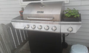 Bbq for sale moving cant take it. Propane tank included