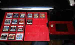 Red 3Ds with 16 Games and Carry Case.