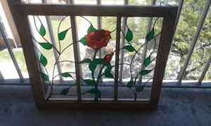Stained glass framed window and chandlier.