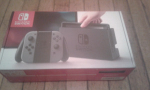 NEW NINTENDO SWITCH CONSOLE  NEVER USED/JAMAIS UTILISÉ WARRANTY