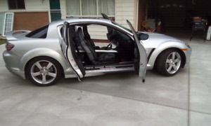 MAZDA RX-8 sharp looking sports car call 519-784-3737