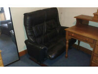 Two seater black leather sofa, metal rocker (on frame), comfortable