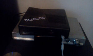xbox 360 with 56 games,controlers and headsts