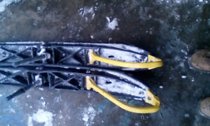 Plastic skis with snow tracker carbides