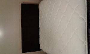 Queen size bed with mattress worth over 900