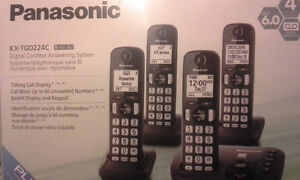 PANASONIC 4 HANDSETS WITH ANSWERING MACHINE(NEW IN BOX)