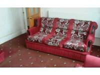Three piece sofa set in red floral design in very good condition.
