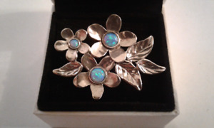 Sterling silver and opal brooch.