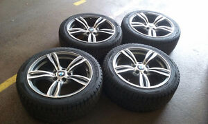 """Set of Used 18"""" BMW Replica with winter tires"""