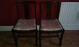 A pair of vintage chairs.