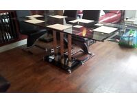 designer dining table with extendable leafs. black & clear glass top & base & chrome central support