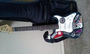 Squier electric guitar and case