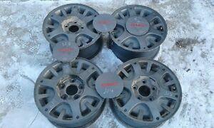 "Four - 15"" alloy GMC rims with center caps"