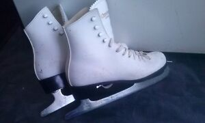 "size 6 ""Dominion"" skates with blade protectors"