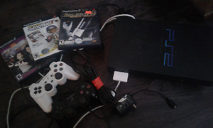 PS2 w/ 2 controllers and 3 games