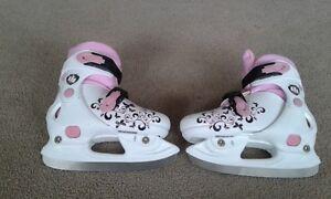 Girl's adjustable  skates size j1, j2, 1, 2