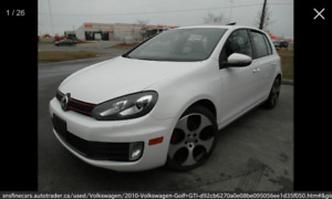 2010 VW GTI Manual trans on Black leather with Navigation.