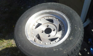 4 Aluminum mag wheels for small GM car four lug with tires.