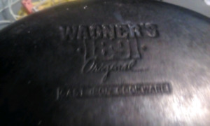 2 cast iron frying pans one large and one small