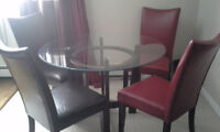 600$. Selling Dufresne Glass dining table with 4 leather chairs