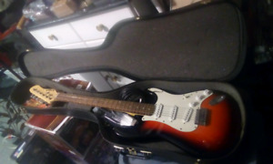 Electric guitar and case guitar tuner strap and amp