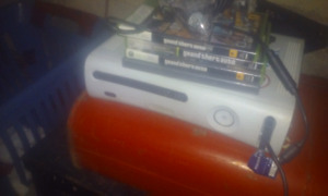 xbox 360(no wifi) and 4 games