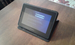 BlackBerry Playbook Tablet with quick charging pod.