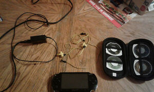 Sony PSP for sale with 4 games and headphones
