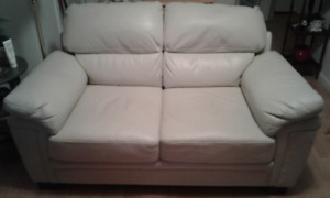 White leatherette love-seat
