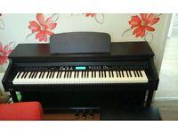 Digital piano in rosewood finish