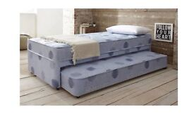 Single bed pulls out into two single beds
