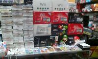 Wii console+2controls+all wires+stand=$49.99 tax incl.