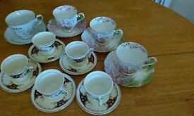 a selection of cups and saucers,mixed.