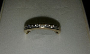 14 k gold ring with 12 diamonds along the band