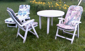 table & 2 chairs & lounge & cushions