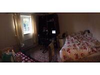 En suite double bedroom overlooking stoke park