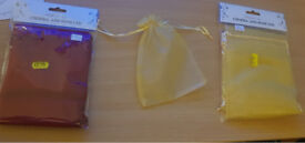 12 packs of ten wedding favour bags. New. 15cmx12cm. were £2.49 per pack, now £1. red and gold.