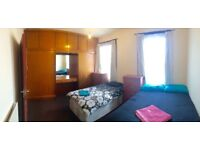 Extra large twin room at St. Mary's Rd, E10, East London