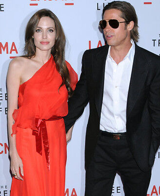 Angelina Jolie carries off the one-shoulder look with style. Grab yourself a Brad Pitt accessory if you can find one!