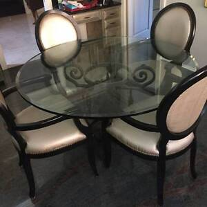 ROUND GLASS DINING ROOM TABLE AND FOUR CAPTAINS CHAIRS