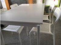IKEA dining table with four chairs