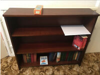Small bookcase, solid wood, 3 shelves, £10. Good condition.