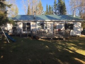 COTTAGE AUCTION: Lakefront-Wellman Lake MB in the Duck Mountains