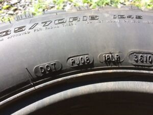 4 Pacemark studded winter tires, on rims.