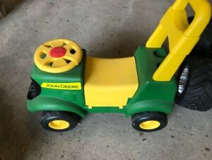 Two great toys - ride-on tractor plus Fisher-Price slide centre!