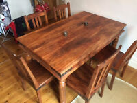 Indian wood dining table and six chairs