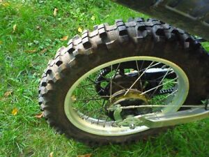 will trade kenda  trackmaster 110 80 x18 tire for less aggresive
