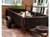 2 wheeled wooden trailer. Length 13 ft, Width 5ft 10 inches approx