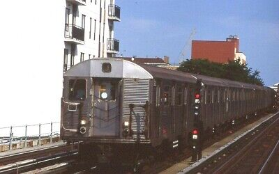 NYCTA Transit slide. Old 1969 R32 cars on J line subway express. Chauncey St